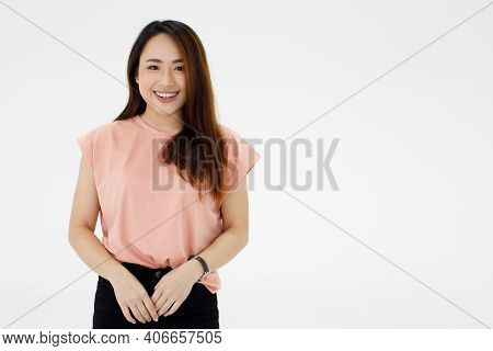 Portrait Of Young Pretty Asian Woman With Beautiful Long Hair And Fair Skin Wearing Casual Dress Pos