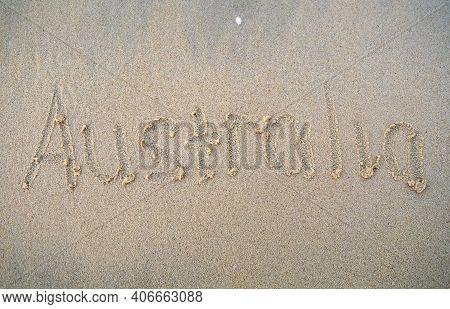 Australia Words Written On Beach Sand. Australia Inscription Is Written On A Sand.