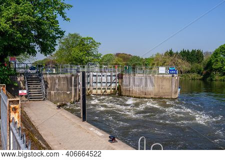 A View Of The Lock On The River Thames At Molesey, Surrey
