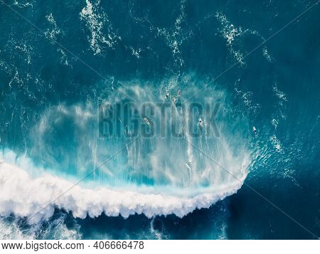 Aerial View Of Blue Ocean With Big Wave And Surfers. Blue Waves In Ocean And Surfers