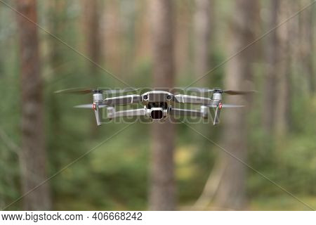 Drone Quadcopter With Camera With Nd Filter Hovers Above The Ground In Flight. Unmanned Aerial Vehic