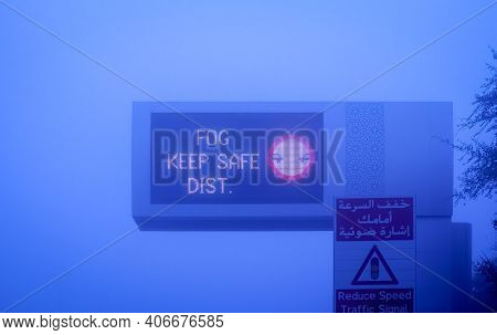 Road In The Fog, Sign Mention Keep Distance For Motorists At Dubai Road, Foggy Weather In Uae, Dense