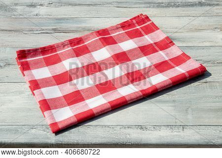 Empty Table Product. Closeup Of A Empty Red Checkered Tablecloth Or Napkin On A Rustic Bright Table.