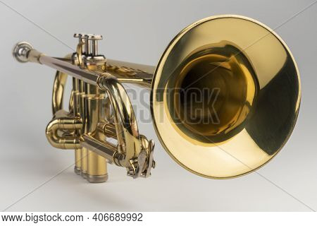 Gold Colored Trumpet As An Isolated Musical Instrument Against A White Background In A Studio