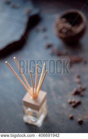 Air Freshener With Bamboo Sticks And Perfume In Glass. Dark Textured Background.invigorating Coffee
