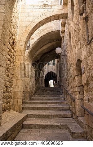 An Ancient Staircase, In The Old Jewish Quarter Alleys, Arches And Old-style Buildings, A Metal Rail