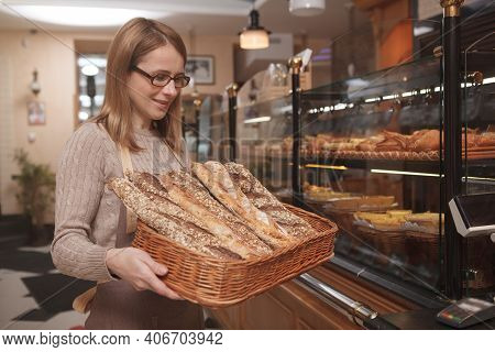 Professional Baker Carrying Bread Basket, Working At Her Bakery Shop, Copy Space