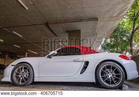 Bangkok, Thailand - 14 Jan 2021 : The Side Of Wheel Of White Ferrari Sports Car Parked In The Parkin
