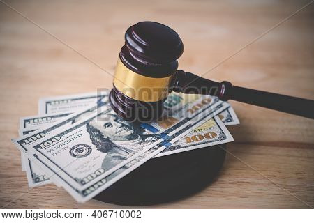 Law And Justice Concept. Judge Hammer With The Dollar Placed - Concept Of Judgment And Justice. Abou