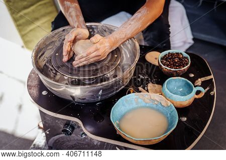 Close-up Of The Hands Of A Woman Ceramist Working With A Potter's Wheel In A Cozy, Bright Workshop.