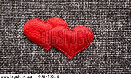 Red Hearts On Gray Textile Background. Close-up Macro