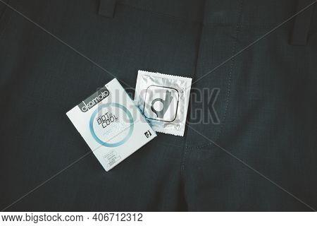 Samut Prakan, Thailand - February 2, 2021 : Box Of Okamoto Dot De Cool Condom 52mm On Man Blue Slack