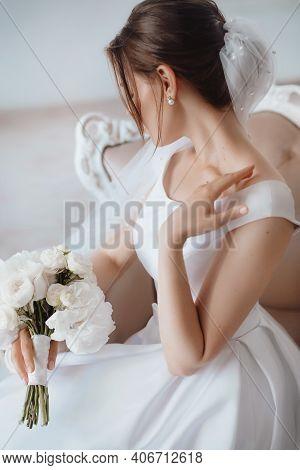 Fine Bride In A Wedding Dress In A Bright Room