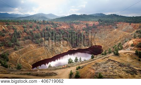 Red Lake In Crater Of Abandoned Kokkinopezoula Open-pit Copper Mine Near Mitsero, Cyprus. Its Odd Co