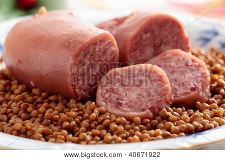 cotechino trotter sausage with lentils on plate poster