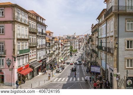 Rua Dos Clerigos - Main Street In Porto Full Of Businesses And People During Summer Day