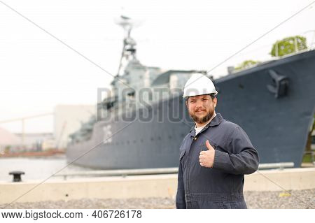 Portrait Of Marine Chief Mate Standing Near Big Vessel In Background, Showing Thumbs Up.