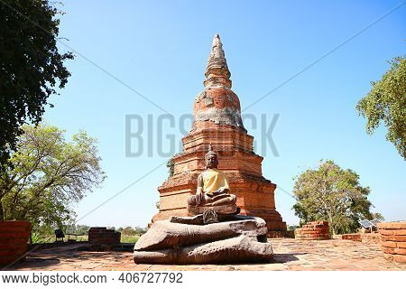 Historic Pagoda And Buddha Images Of Wat Phra Ngam Temple Ruins In Ayutthaya Old Town, Archaeologica