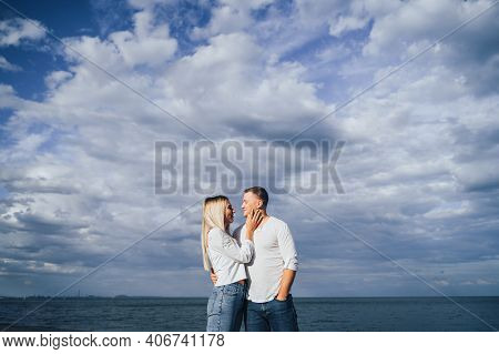 Loving Couple Having Fun - They Laugh, Hug Each Other And Enjoy Warm Summer Evening. A Romantic Coup