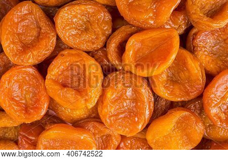 Background Of Dried Apricots. Dried Fruits Of Close Up. Top View. Background Of Dried Fruits. Dried