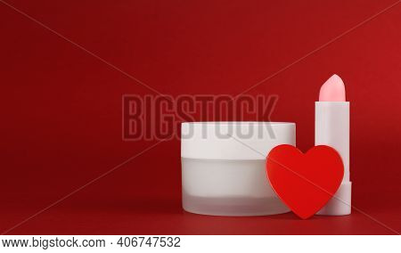Jar Of Cream And Lip Balm On A Red Background With Heart. Container For Body Care Balm. Concept Back