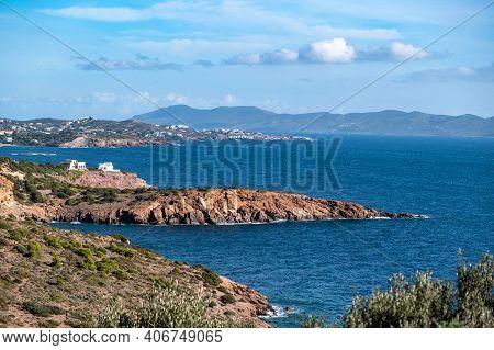 Greece Cape Sounio Landscape, Athens Attica. Coastline, Rippled Sea, Cloudy Blue Sky Backgrpund, Sun