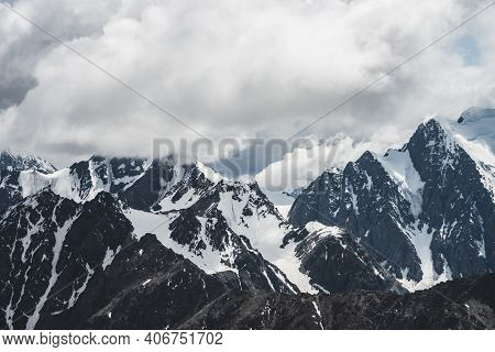 Atmospheric Minimalist Alpine Landscape With Massive Hanging Glacier On Big Mountain Under Cloudy Sk