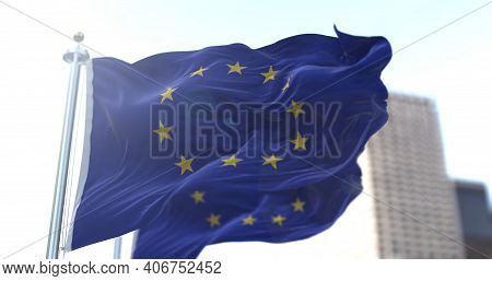 Two European Flags Flapping In The Wind. European Union And Economic Community. Politics And Economy