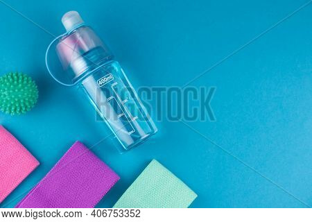 Colorful Fitness Gums On Blue Background. Elastic Expanders And Tapes Of Different Color. Colored Ru