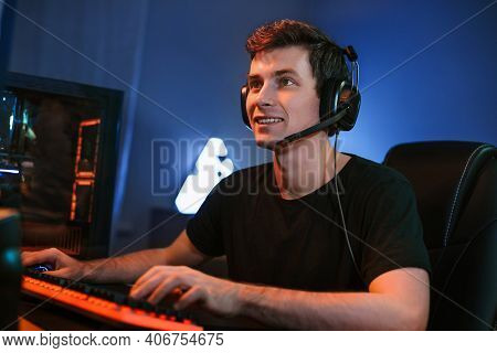 Young Caucasian Handsome Professional Cybersport Player Training Or Playing Online Video Game On His