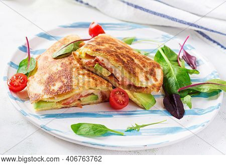 Tasty Breakfast With Quesadilla And Eggs. Mexican Cuisine. Trending Food With Omelet, Cheese, Tomato