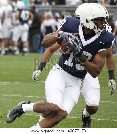 An Unidentified Penn State receiver catches the football