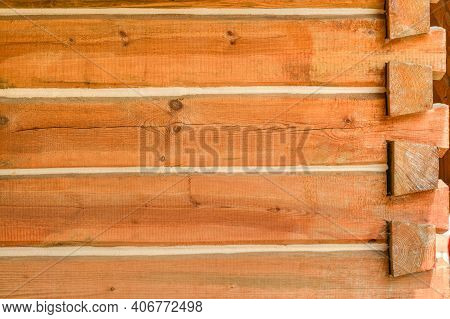 Corner Of A House Built With Timber Bars