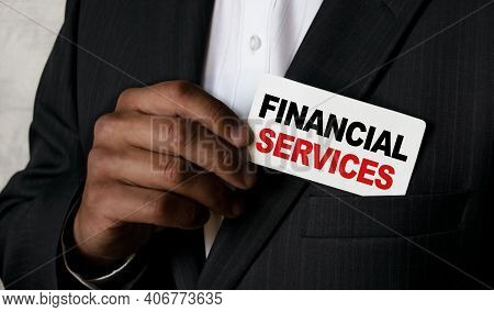 Close Up View Of A Black Man Holding A Business Card. A Young African Businessman Takes Out A Busine