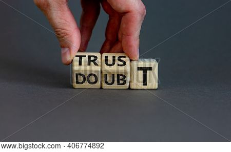 Trust Or Doubt Symbol. Businessman Flips Wooden Cubes And Changes The Word Doubt To Trust. Beautiful