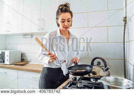 Homemade Woman Likes To Cook Delicious Desserts From Natural Products. Making Banana Pancakes, Turni