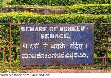 Badami, Karnataka, India - November 7, 2013: Cave Temples Above Agasthya Lake. White On Blue Large W