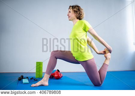 Female Fitness Athlete Doing Warm Up Workout. Stretching Exercises At Gym. Woman Muscle Stretching L