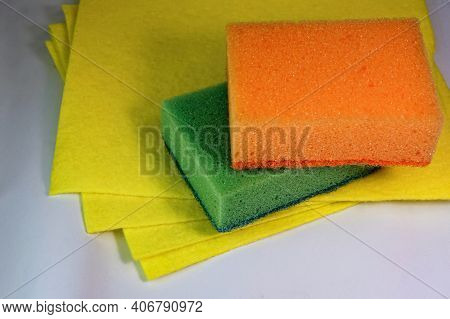 Kitchen Sponges And Napkins Close Up. Cleaning Equipment And Products. Kitchen Multicolored Orange A