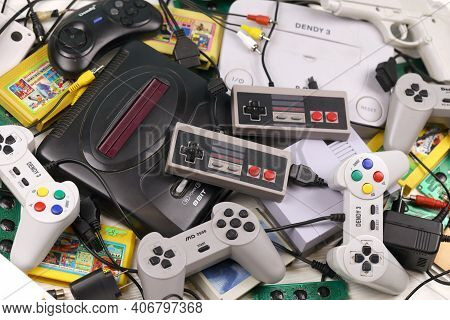 Kharkov, Ukraine - December 27, 2020: Pile Of Old 8-bit Video Game Consoles And Many Gaming Accessor