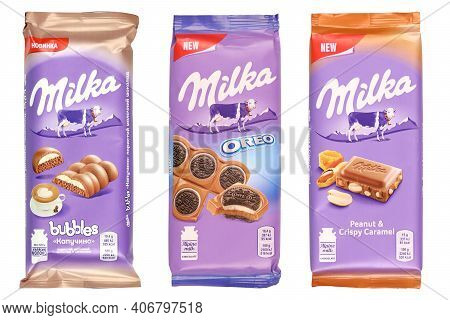 Kharkov, Ukraine - December 8, 2020: Purple Milka Chocolate Bars On White Background. Milka Is A Swi