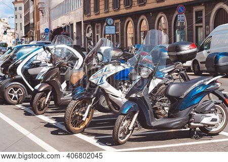 Motorcycles Parked In A Row In European City Center. Motorbike Group Parking On Street During Advent