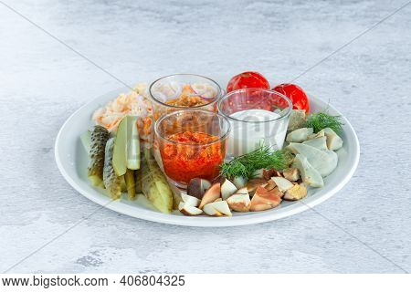 Assortment Plate Of Pickled Vegetables, Chopped Marinated Mushrooms, Cucumbers, Tomatoes