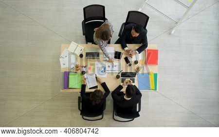 Business Executives Team Meeting 2021 Business Plan In Modern Office With Laptop Computer, Tablet, M