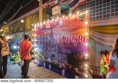 Bangkok/thailand-01 Mar 2020:unacquainted People Walking In Wat Arun Temple Fair At Night.wat Arun R