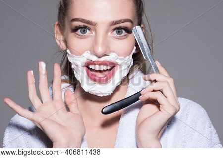 Woman With Sharp Blade Of Straight Razor. Barber And Shaving Concept. Female Barber Shaving Face In