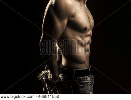 Sexy Man With Muscular Body With Tied Hands By Rope