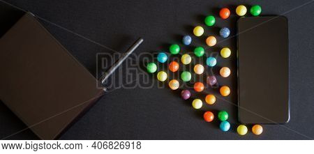 Black Router, Smartphone And Multicolored Balls On A Dark Background. Symbol For Wireless Data Trans