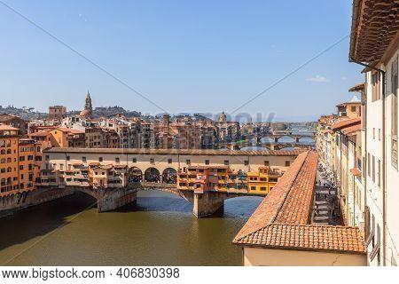Ponte Vecchio Over The Arno River And The Vasari Corridor (corridoio Vasariano) In Florence