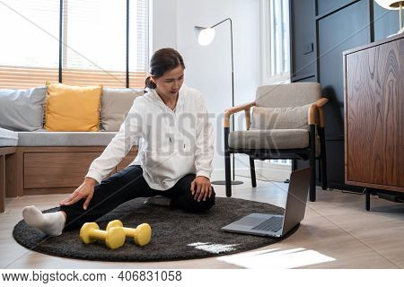 Attractive And Healthy Young Asian Woman Doing Exercising At Home During Workout In Comfy Clothes On